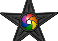 Wikipedia's photographer barn star is a black star with a multicoloured aperture in the centre.